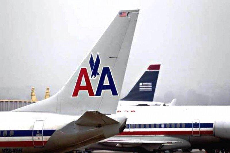 US Airways y American Airlines crean la mayor aerolínea del mundo