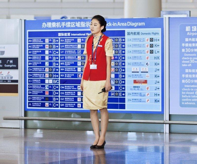 Una azafata en el aeropuerto de Pekín. #shu#