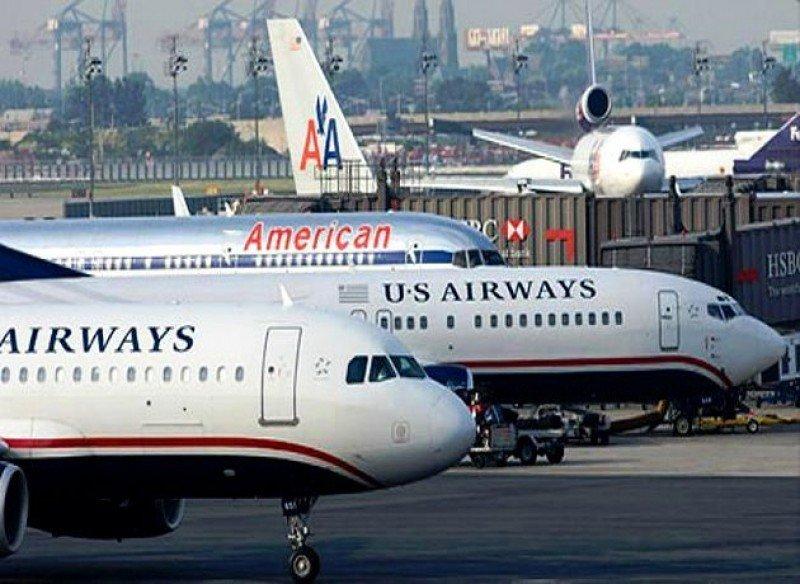 Los accionistas de US Airways aprueban la fusión con American Airlines