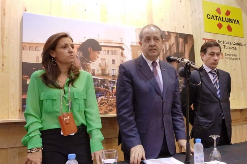 Marián Muro, directora general de Turismo; el consejero Felip Puig; y Xavier Espasa, director de la Agencia Catalana de Turismo.