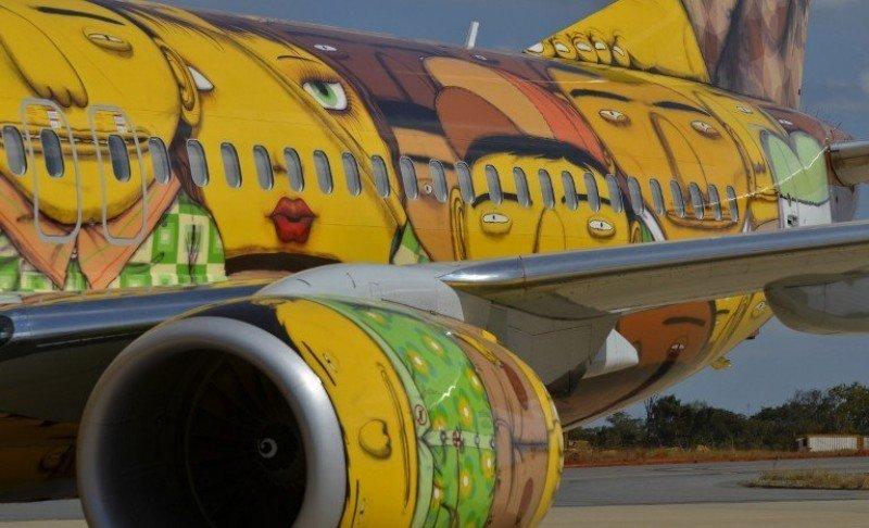 Los rostros de gente común caracterizan la obra de los populares grafiteros brasileños.
