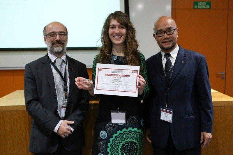 Estela Mariné con Lorenzo Cantoni, Presidente del IFITT, y Zhen Xiang, co-director del 2015 ENTER PhD Workshop.