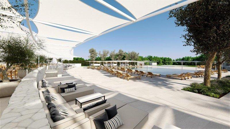 El Hotel Camiral dispondrá de piscina exterior con servicio de bar y vistas al campo de golf.