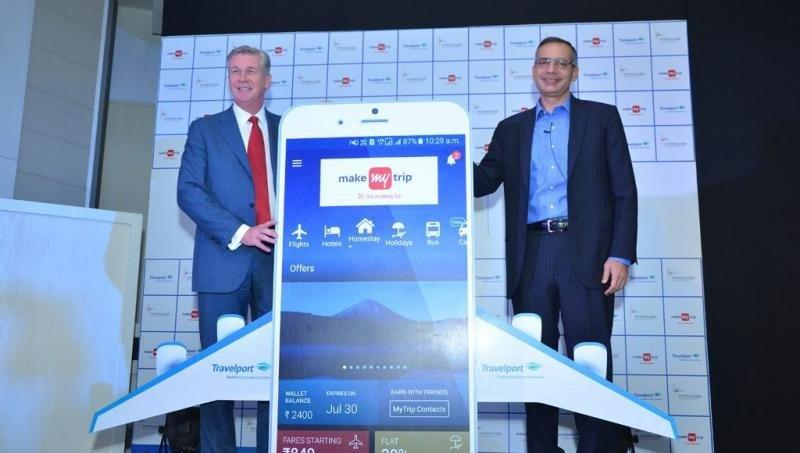 El CEO de Travelport, Gordon Wilson y el de MakeMyTrip, Deep Kalra (de izqu. a dcha.).