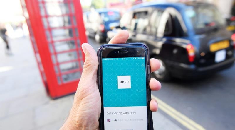 Uber get out (foto: © Toby Melville / Reuters).